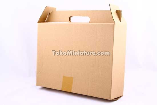 Packaging miniatur kapal cost guard